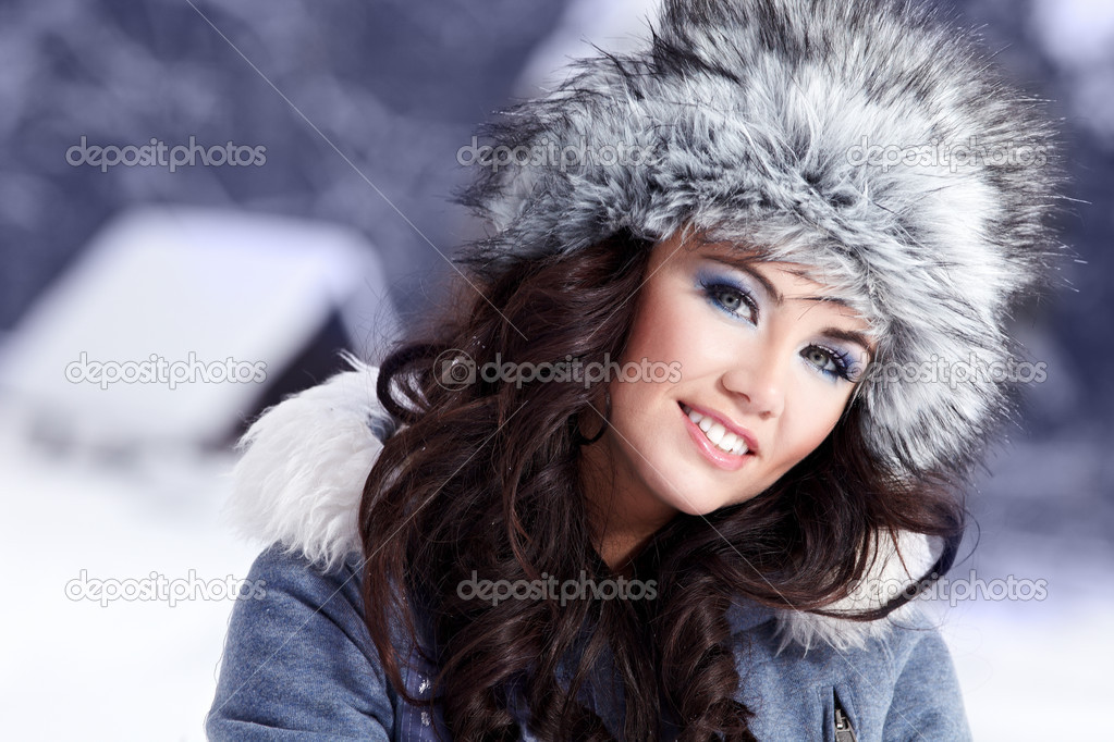 Happy young  woman plays with a snow — Stock Photo #1660388