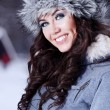 Beautiful woman playing with snow — Stock Photo #1776110