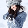 Beautiful woman playing with snow — Stock fotografie