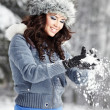 Foto Stock: Beautiful woman playing with snow