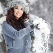 Foto de Stock  : Beautiful woman playing with snow