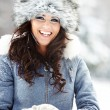 图库照片: Beautiful woman playing with snow