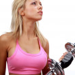 Blonde is working out with weights — Stock Photo