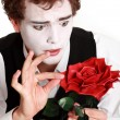 Stock Photo: Mime holding rose ,