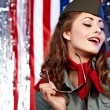 Sexual pinup woman in military clothing - Stock Photo