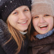 Two girls in a winter season — Stockfoto