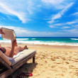 Foto Stock: Relaxing on the beach