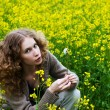 Girl in flowers — Stock Photo