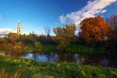 Autumnal lake and church — Stock Photo