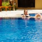 Girl in swimming pool — Stock Photo #1619112