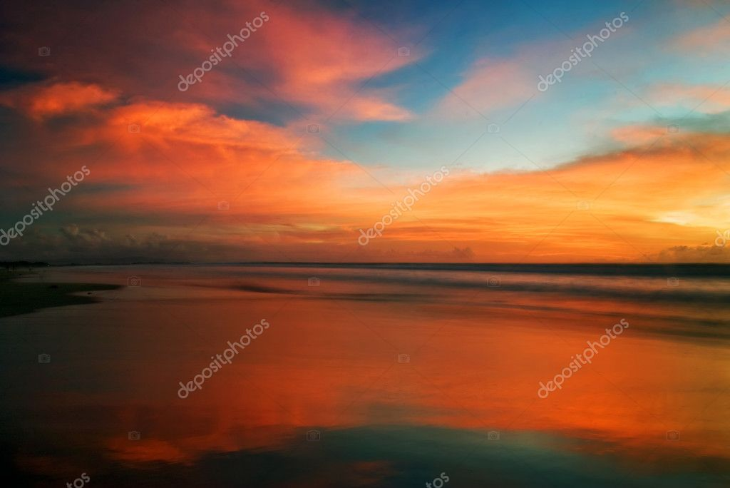 Sunset on tropical beach. Legian beach. Bali island, Indonesia — Stock Photo #1618706