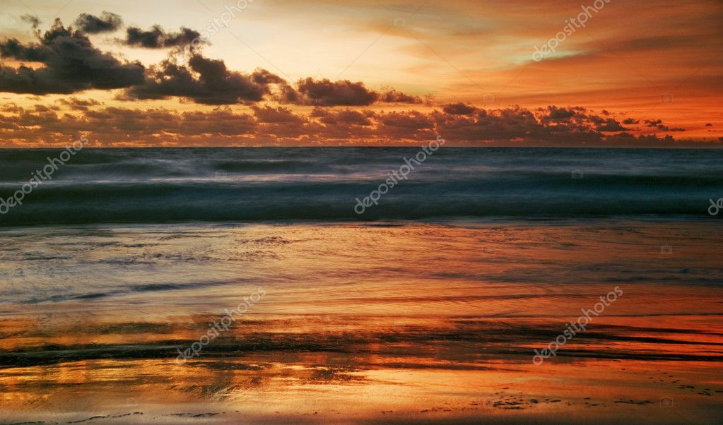 Sunset on tropical beach. Legian beach. Bali island, Indonesia — Stock Photo #1618720