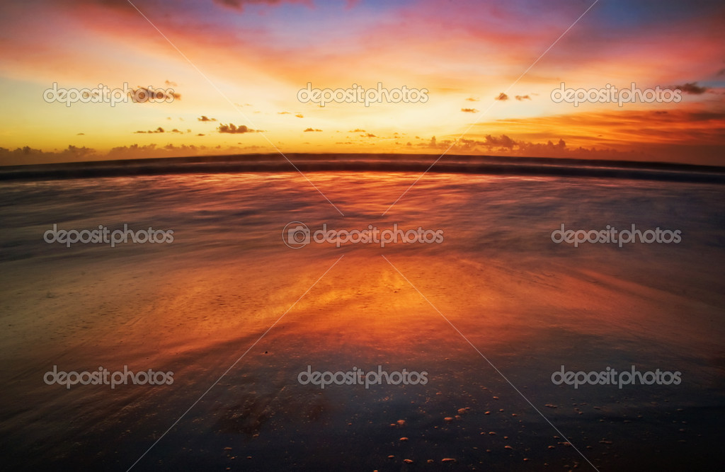 Sunset on tropical beach. Legian beach. Bali island, Indonesia — Stock Photo #1619060
