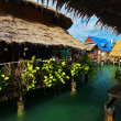 Asian Village on stilts in the sea — Stock Photo
