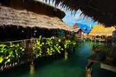 Asian Village on stilts in the sea — Stock Photo