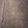 Cracked asphalt background - Stock Photo