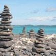 Stock Photo: Beach and Piles of stones