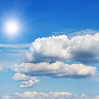 Blue sky with cloud and sun — Stockfoto