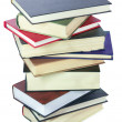 Stock Photo: Stack of books isolated over white