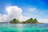 Island in beautiful tropical sea — Stock Photo