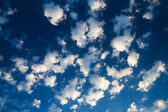 Blue sky and lots small white clouds, ma — Stock Photo