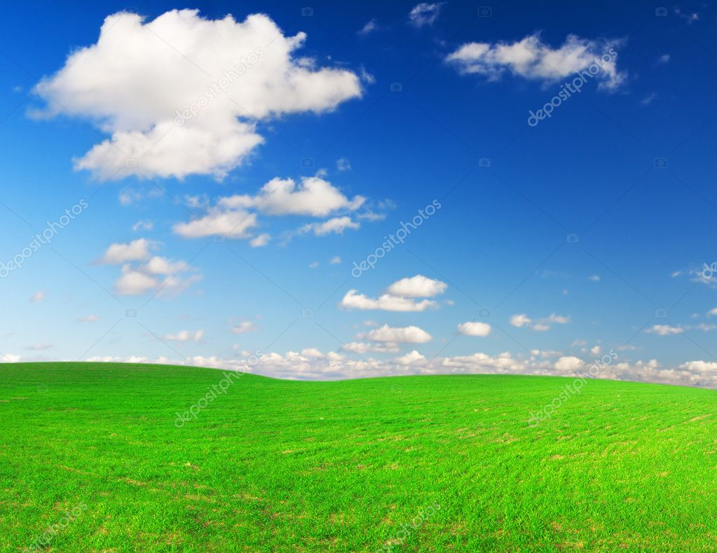 Green hill under blue cloudy sky whit sun — Stock Photo #1617414