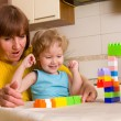 Baby with grandmother plays cubes — Stock Photo