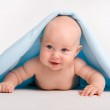 Beautiful baby under towel — Stock Photo