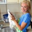 Beautiful woman washes ware — Stock Photo