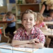 Boy in school class — Stock Photo