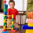 Boy plays with cubes — Stock Photo