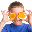 Boy with an orange — Stock Photo