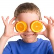 Boy with an orange — Stockfoto
