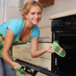 Royalty-Free Stock Photo: Girl cooks food in an oven