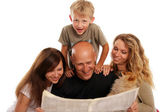 Family reads the newspaper — Stock Photo