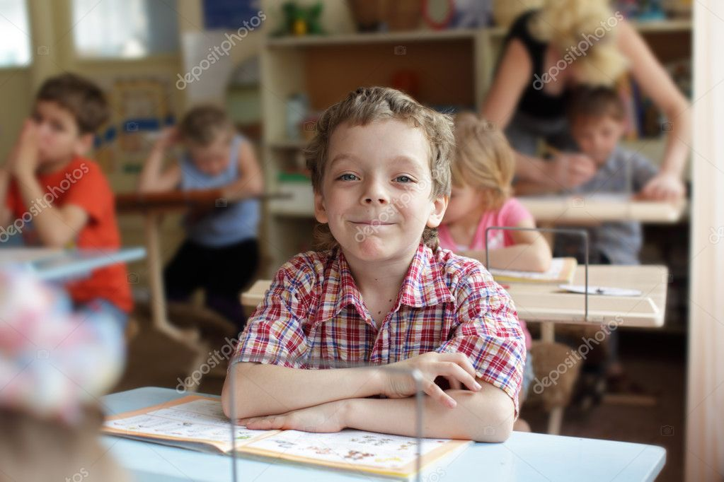 Smiling boy in school class — Stock Photo #1838476