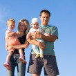 Happy family against the sky — Stock Photo #1841718