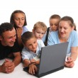 Big happy family with the laptop — Stock Photo