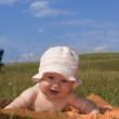 Happiness baby on meadow — Stockfoto #1845295