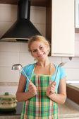 Women with ladle on kitchen — Stock Photo