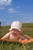 Happiness baby on a meadow — Stock Photo