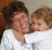 Happy prograndmother with granddaughter — Stock Photo