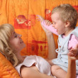 Cheerful mum plays with a daughter — Stock Photo