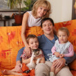 Happy family of the house on a sofa 2 — Stock Photo