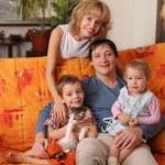 Happy family of the house on a sofa 2 — Stock Photo