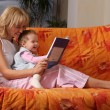 Mum reads the book to a daughter — Stock Photo