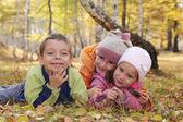 Happy children in autumn park 5 — Stock Photo