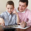 Father training the son to the finance - Stock Photo