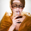 Girl in a mask with a glass — Stock Photo