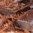 Slices of black bitter chocolate — Stock Photo
